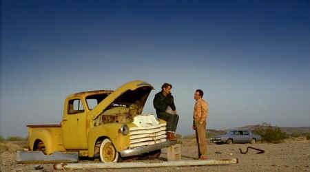 broken car in the desert