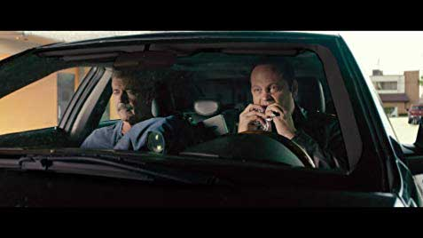 Mel Gibson and Vince Vaughn eating in the car